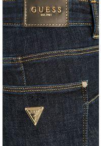 Guess - Jeansy Curve X. Kolor: niebieski. Wzór: gładki