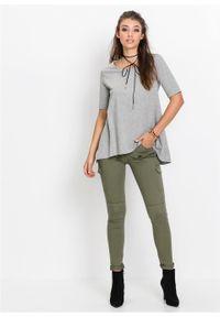 Spodnie bojówki Skinny bonprix oliwkowy. Kolor: zielony