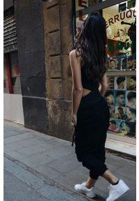MUUV - Top Walkin Rio. Kolor: czarny. Materiał: materiał. Długość rękawa: na ramiączkach. Styl: sportowy