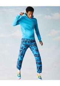Lacoste - LACOSTE - Niebieska bluza z kapturem Unisex Fit. Okazja: na spacer. Typ kołnierza: kaptur. Kolor: niebieski. Materiał: bawełna, prążkowany. Sezon: wiosna