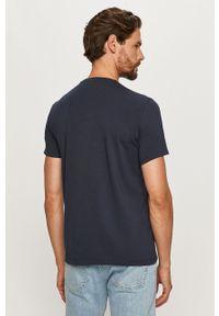 Niebieski t-shirt Armani Exchange z okrągłym kołnierzem, z nadrukiem
