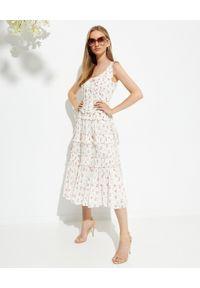 NEEDLE & THREAD - Sukienka midi w kwiaty Theresa. Typ kołnierza: dekolt gorset. Kolor: beżowy. Materiał: bawełna. Długość rękawa: na ramiączkach. Wzór: kwiaty. Typ sukienki: gorsetowe, rozkloszowane. Długość: midi