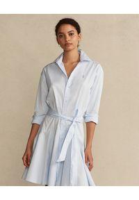 Ralph Lauren - RALPH LAUREN - Niebieska sukienka koszulowa. Typ kołnierza: kołnierzyk klasyczny, polo. Kolor: niebieski. Materiał: tkanina, bawełna. Długość rękawa: długi rękaw. Typ sukienki: koszulowe. Styl: klasyczny