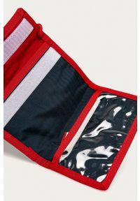 Tommy Jeans - Portfel. Kolor: niebieski. Materiał: materiał. Wzór: gładki