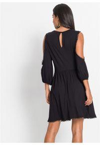 Sukienka z dżerseju z wycięciami i koronką bonprix czarny. Kolor: czarny. Materiał: jersey, koronka. Wzór: koronka