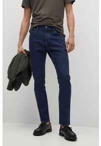 Turkusowe jeansy Mango Man gładkie