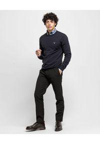 GANT - Granatowy sweter z wełną. Okazja: na co dzień. Kolor: niebieski. Materiał: wełna. Długość rękawa: długi rękaw. Długość: długie. Wzór: haft. Styl: casual