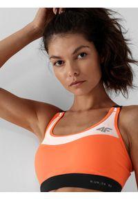 4f - Biustonosz do biegania ze średnim wsparciem damski. Kolor: pomarańczowy. Materiał: włókno, materiał. Sport: fitness