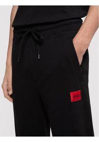 Hugo Spodnie dresowe Doak212 50447963 Czarny Regular Fit. Kolor: czarny. Materiał: dresówka
