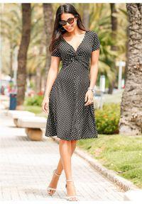 Sukienka z dżerseju bonprix czarno-biały w kropki. Kolor: czarny. Materiał: jersey. Wzór: kropki