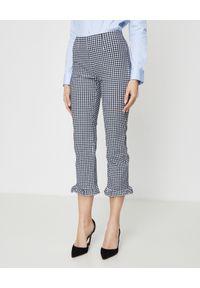 SEDUCTIVE - Modelujące spodnie w kratę. Okazja: na spotkanie biznesowe, na imprezę. Kolor: niebieski. Materiał: materiał. Wzór: gładki. Styl: elegancki, biznesowy