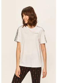 Biała bluzka Diadora z aplikacjami, na co dzień