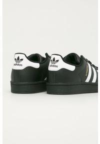 Czarne buty sportowe adidas Originals na sznurówki, z okrągłym noskiem, z cholewką