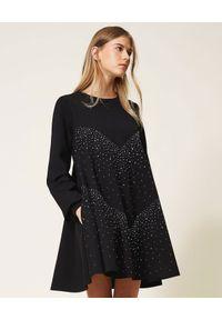 TwinSet - TWINSET - Czarna rozkloszowana sukienka z dżetami. Okazja: do pracy, na co dzień. Kolor: czarny. Materiał: wiskoza, materiał. Długość rękawa: długi rękaw. Typ sukienki: rozkloszowane. Styl: casual. Długość: mini