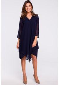 e-margeritka - Sukienka szyfonowa elegancka granatowa - l. Okazja: na wesele, na ślub cywilny, na co dzień, na imprezę. Kolor: niebieski. Materiał: szyfon. Typ sukienki: trapezowe, proste, asymetryczne. Styl: elegancki. Długość: midi
