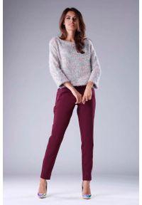 Różowy sweter oversize Nommo krótki