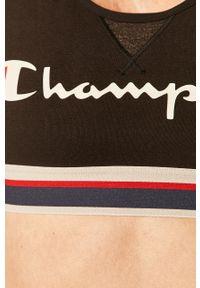 Czarny biustonosz sportowy Champion z odpinanymi ramiączkami, z nadrukiem