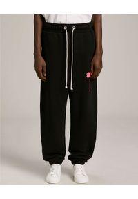PALM ANGELS - Czarne spodnie z palmą. Kolor: czarny. Materiał: dresówka, bawełna. Wzór: aplikacja