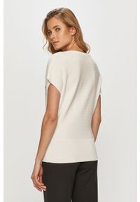 Biały sweter Guess z aplikacjami