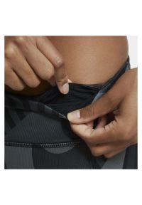 Spodnie do biegania damskie Nike Fast Tight 7/8 Runway CU3114. Materiał: poliester, skóra, materiał. Technologia: Dri-Fit (Nike). Wzór: nadruk