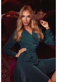 MOE - Zielona Rozkloszowana Sukienka Kopertowa Wiązana w Pasie. Kolor: zielony. Materiał: elastan, poliester. Typ sukienki: kopertowe
