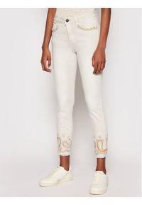 Beżowe jeansy slim Desigual paisley