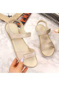 Złote sandały Helios