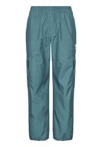 Adidas - adidas Spodnie dresowe adicolor Classics 3-Stripes GN3450 Zielony Regular Fit. Kolor: zielony. Materiał: dresówka