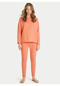 Pomarańczowe bawełniane spodnie dresowe Juvia. Kolor: pomarańczowy. Materiał: bawełna, dresówka