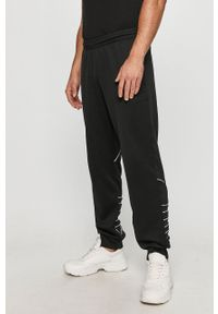 Czarne spodnie dresowe adidas Originals z aplikacjami #4
