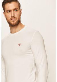Biała koszulka z długim rękawem Guess Jeans z okrągłym kołnierzem
