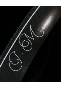 JOANNA MUZYK - Czarne spodnie dresowe z taśmami. Kolor: czarny. Materiał: dresówka. Wzór: aplikacja