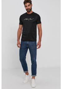 Emporio Armani - T-shirt. Kolor: czarny. Materiał: dzianina. Wzór: aplikacja