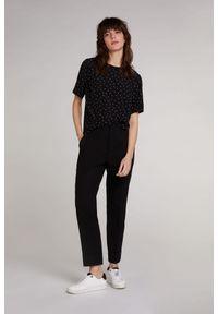 T-shirt w kropki z krótkim rękawem w Oui. Kolor: czarny. Materiał: tkanina, wiskoza. Długość rękawa: krótki rękaw. Długość: krótkie. Wzór: kropki
