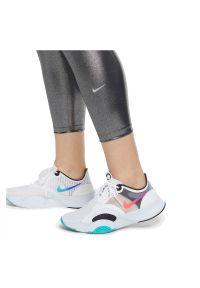 Legginsy damskie Nike One Icon Clash 7/8 CU6030. Materiał: tkanina, poliester, materiał. Technologia: Dri-Fit (Nike). Wzór: gładki. Sport: fitness
