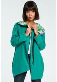 e-margeritka - Bluza damska z kapturem zapinana na suwak zielona - l/xl. Typ kołnierza: kaptur. Kolor: zielony. Materiał: dzianina, materiał, bawełna, elastan. Długość: długie. Wzór: nadruk, kolorowy. Sezon: zima, jesień