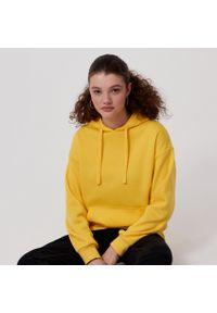 Żółta bluza Cropp z kapturem