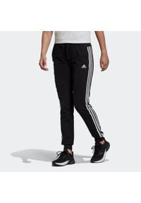 Adidas - Spodnie dresowe fitness. Materiał: elastan, bawełna. Sport: fitness