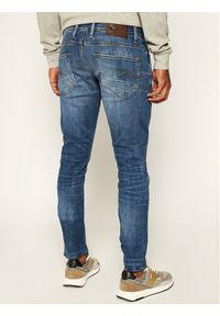 G-Star RAW - G-Star Raw Jeansy Revend 51010-8968-6028 Granatowy Skinny Fit. Kolor: niebieski. Materiał: jeans