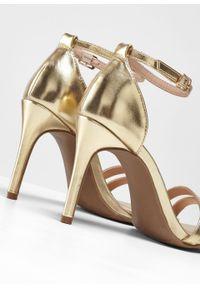 Złote sandały bonprix