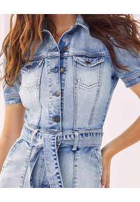 RETROFETE - Jeansowy kombinezon. Kolor: niebieski. Materiał: jeans. Styl: sportowy