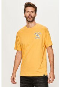 Żółty t-shirt New Balance z okrągłym kołnierzem, z nadrukiem