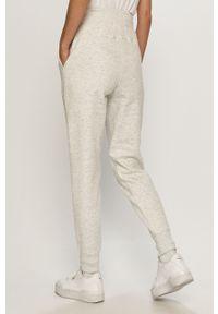 Białe spodnie dresowe 4f gładkie