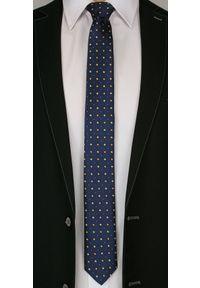 Granatowy Elegancki Krawat -Angelo di Monti- 6 cm, Męski, w Złote Figury Geometryczne. Kolor: niebieski, złoty, żółty, wielokolorowy. Wzór: geometria. Styl: elegancki