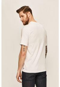 Biały t-shirt Russell Athletic casualowy, z aplikacjami, na co dzień