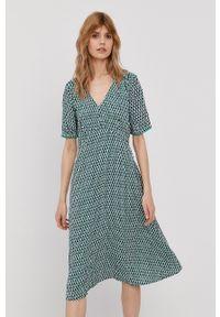 TOMMY HILFIGER - Tommy Hilfiger - Sukienka. Materiał: tkanina. Długość rękawa: krótki rękaw. Typ sukienki: rozkloszowane