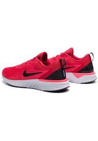 Czerwone buty do biegania Nike z cholewką