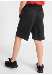 Spodnie sportowe bonprix czarny z nadrukiem. Kolor: czarny. Wzór: nadruk. Styl: sportowy