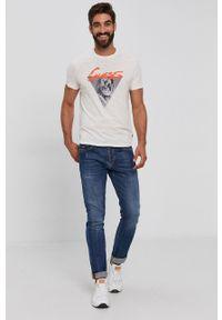 Guess - T-shirt bawełniany. Okazja: na co dzień. Kolor: beżowy. Materiał: bawełna. Wzór: nadruk. Styl: casual