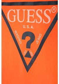 Pomarańczowy t-shirt Guess Jeans z nadrukiem, na co dzień